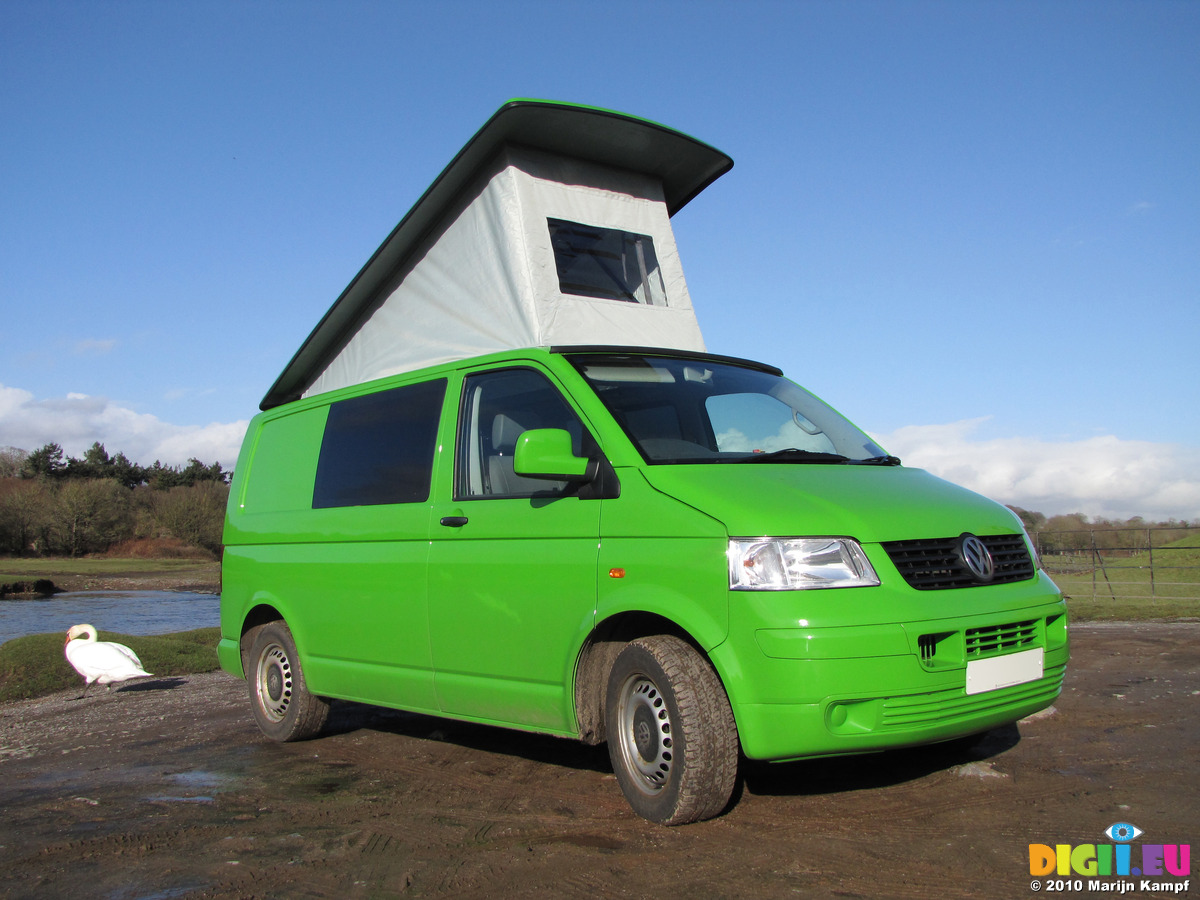SX12376 Our Green VW T5 Campervan With Popup Roof Up At Ogmore Castle
