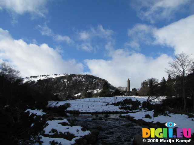 SX02452 Glendalough St Kevin's Church and Round Tower in snow