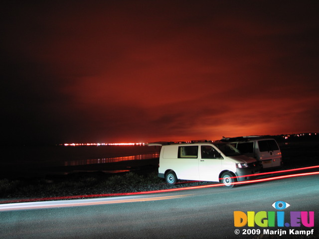 SX07687 Campervans at night on Ogmore by Sea beach