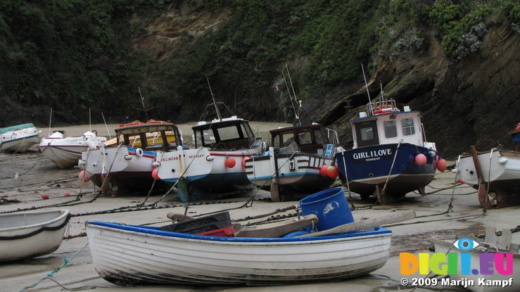 SX08777 Small boats on dry harbour floor in Newquay