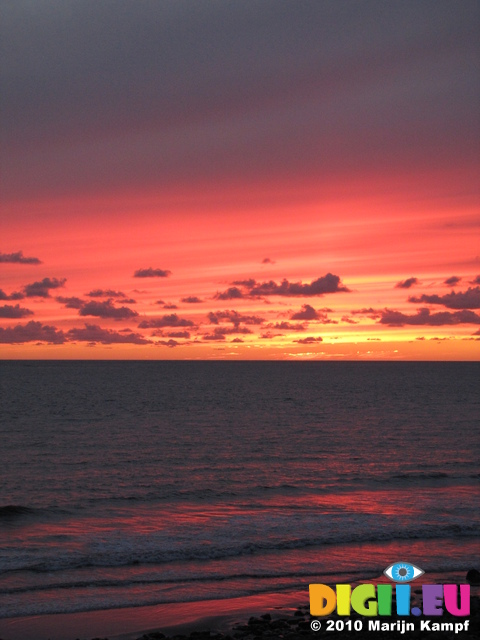 SX16495 Red sky from sunset over sea at Ogmore by Sea