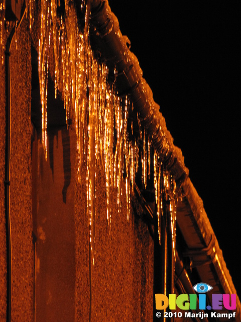 SX17123 Icicles hanging from gutter in Bridgend