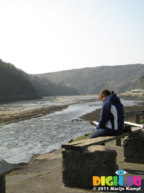 SX17726 Jenni reading at Solva Harbour