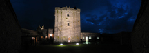 26995-27001 Dunguaire Castle court yard at night.jpg