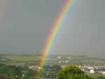 27058 Rainbow over fields and houses.jpg