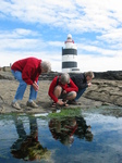 27545 Oma, Machteld and Marjan staring into a pool at Hook Head Lighthouse.jpg