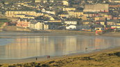 SX00648 People walking Tramore beach.jpg
