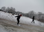 SX02192 Dylan snowboarding on to let sign in Hilly Fields Park, Enfield.jpg
