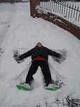 SX02235 Dylan making snow angel.jpg