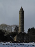 SX02443 Glendalough Round Tower in snow.jpg