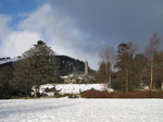 SX02573 Round Tower Glendalough in snow.jpg