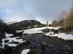 SX02580 Glendasan river in front of Round Tower Glendalough in snow.jpg