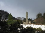 SX02586 Round Tower Glendalough in snow.jpg