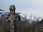 SX02633 Celtic cross in Glendalough with view to Lugduff mountain.jpg