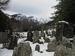 SX02677 Snow on tomb stones in Glendalough with view to Lugduff mountain.jpg