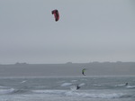 SX02952 Kitesurfers jumping from wave at Tramore beach.jpg
