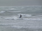 SX02957 Kitesurfer jumping from wave at Tramore beach.jpg
