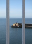 SX03000 Lighthouse of Rosslare harbour through ferry railing.jpg