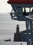 SX03018 Silhouette of captain on bridge of car ferry pulling out Rosslare harbour.jpg