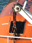 SX03027 Detail of crane holding orange lifeboat.jpg
