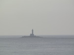 SX03051 Silhouette of Lighthouse near Rosslare on rocky outcrop.jpg