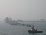 SX03448 Oil tanker in the mist and tug boat.jpg