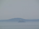 SX03495 Lighthouse and islands in the mist.jpg