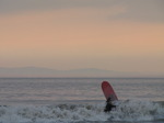 SX03511 Surfer in surf at Ogmore by Sea.jpg