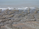 SX05166 Layers of rock slabs at beach.jpg