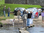 SX05744 Crossing stepping stones at Ogmore Castle.jpg