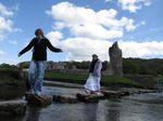 SX05748 Libby, Annie and Laura crossing stepping stones at Ogmore Castle.jpg