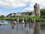SX05767 Chaos crossing stepping stones at Ogmore Castle.jpg