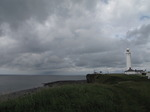 SX06651 Dark clouds over Nash Point lighthouse.jpg