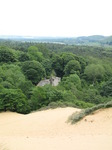 SX06785 Remains of Candleston Castle sticking out of trees seen from Merthyr-mawr Warren sand dunes.jpg