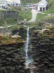 SX07260 Waterfall framed by Tintagel Castle medieval wall.jpg