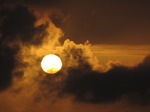 SX07434 Sun shining through clouds at dusk.jpg