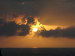 SX07436 Sun shining through clouds at dusk.jpg