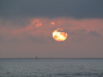 SX07463 Sailboat on horizon at sunset.jpg