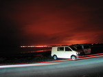 SX07687 Campervans at night on Ogmore by Sea beach.jpg