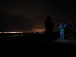 SX07700 Laura playing with poi night time sillouette at Ogmore by Sea beach.jpg