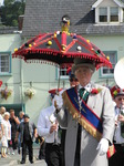 SX07890 Adamant led by man with decorated umbrella at Brecon Jazz Parade.jpg
