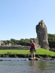 SX07970 Kristina crossing stepping stones at Ogmore Castle.jpg