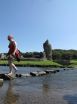 SX07975 Kristina crossing stepping stones at Ogmore Castle.jpg