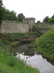 SX08143 Reflection in moat of tower in Cardiff Castle wall.jpg