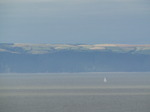SX08279 Sailboat at Devon coastline taken across bay from Ogmore by Sea.jpg
