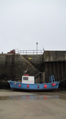 SX08775 Small blue fishing boat in Newquay Harbour.jpg
