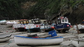 SX08777 Small boats on dry harbour floor in Newquay.jpg