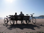 SX08990 Jenni and Marijn sitting on bench with push bikes at Penzance promenade.jpg