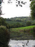 SX09635 Sunny hills reflected in Monmouthshire and Brecon Canal.jpg