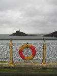 SX09938-9 Life buoy on Mumbles pier and Mumbles Head Lighthouse copy.jpg